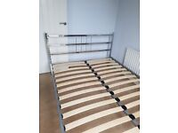 Chrome framed double bed with mattress