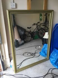 Large mirror with gold trim