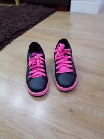 Pink and black heelies. In very good condition