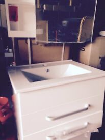 Bathroom vanity unit with basin and taps