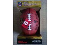 "Wilson ""The Duke"" Football, and Patriots cap."