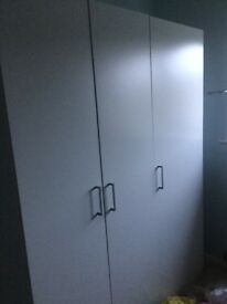 Three door white wardrobe