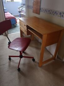 Wooden desk with 2 drawers and office swivel chair.