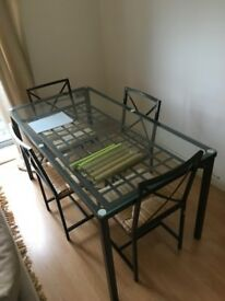 IKEA Glass Dinning Table with Four Chairs