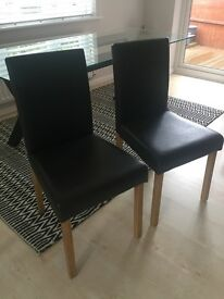 2 dark brown faux leather dining chairs