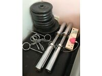 Rarely been used oymplic weights and dumbbell