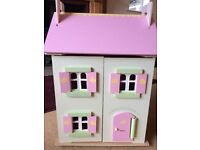 Pretty wooden dolls house with furniture and dolls