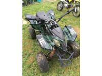 Quad bike with Honda C90 engine.