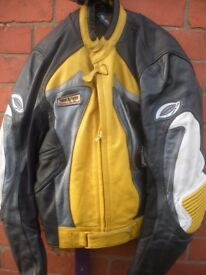 """REV IT""... 2 PIECE BLACK / YELLOW MOTOR CYCLE LEATHERS EURO SIZE 52"