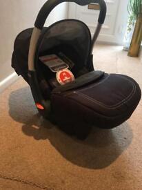 New silver cross car seat