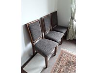 6 Dining Chairs, dark wood , upholstered. In new condition.