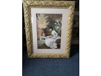 A BEAUTIFUL LARGE FRAMED PRINT OF A LADY SITTING LOOKING THROUGH PICTURES