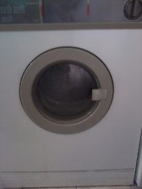 TUMBLE DRYER: ZANUSSI - model TD 200 plus flexible trunking and the instruction book