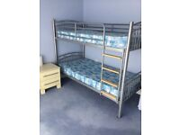 Metal framed bunk beds with mattresses