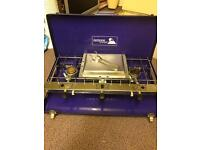 Outdoor camping stove in foldaway carrying case