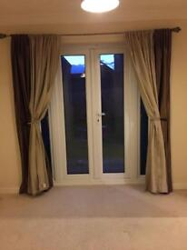 Ivory/beige and dark bronzey green curtains