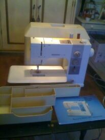 Vintage Bernina 910 electronic sewing machine, with foot control and original instruction book.