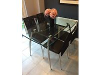 Glass dining table and 4 chairs for sale