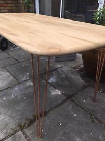 Stunning ercol plank top table with copper legs
