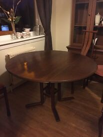 Dark wood ercol extendable dining table