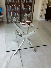 Bought Jan 2018 beautiful glass and chrome dining table. Seats 6/8. Cost £500.
