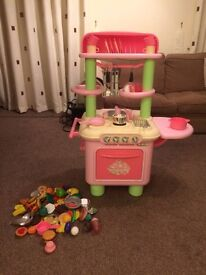 ELC Pink Sizzling kitchen with food. Excellent condition. A fun kitchen for toddlers to play with.