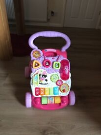 Pink Vtech First Steps Baby Walker.A 2-in-one walker and activity centre in very good condition