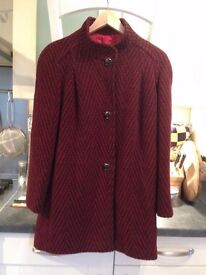 Women's herringbone coat in red and black with three black buttons and red lining.Two side pockets.