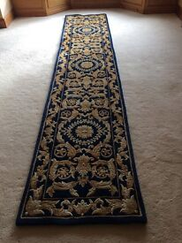 """Handmade 100 per cent wool oriental runner rug, 12ft by 2'6"""" in blue from GH Frith of Cannock"""
