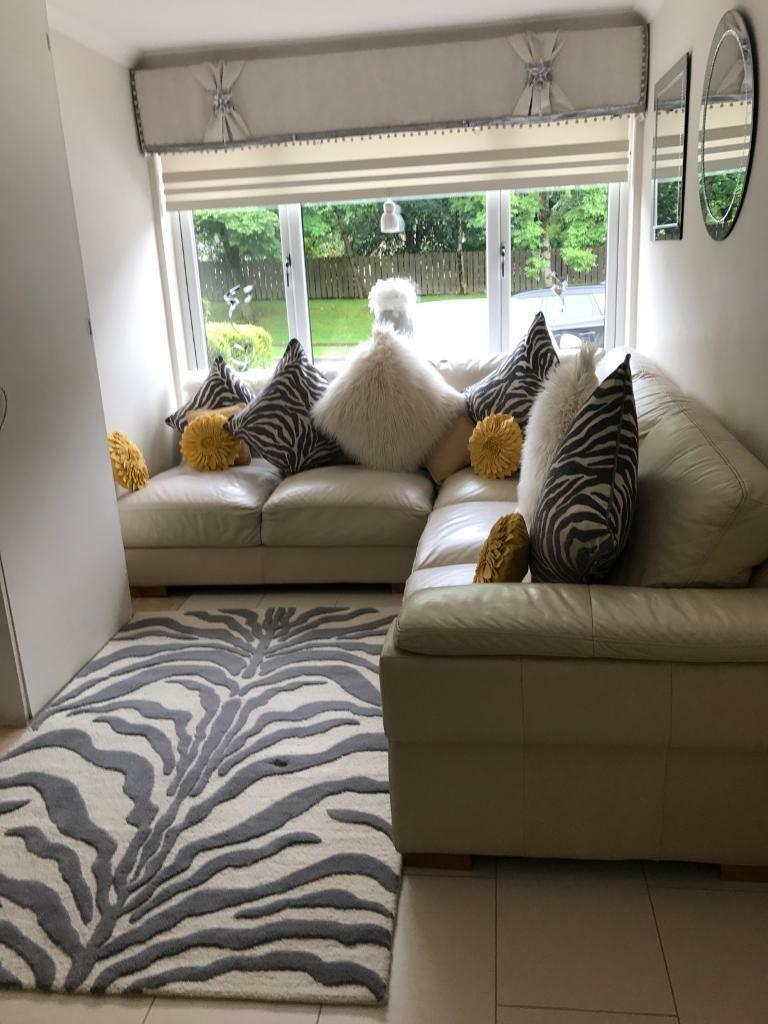 Cream Leather Sofa With All Cushions And Matching Rug