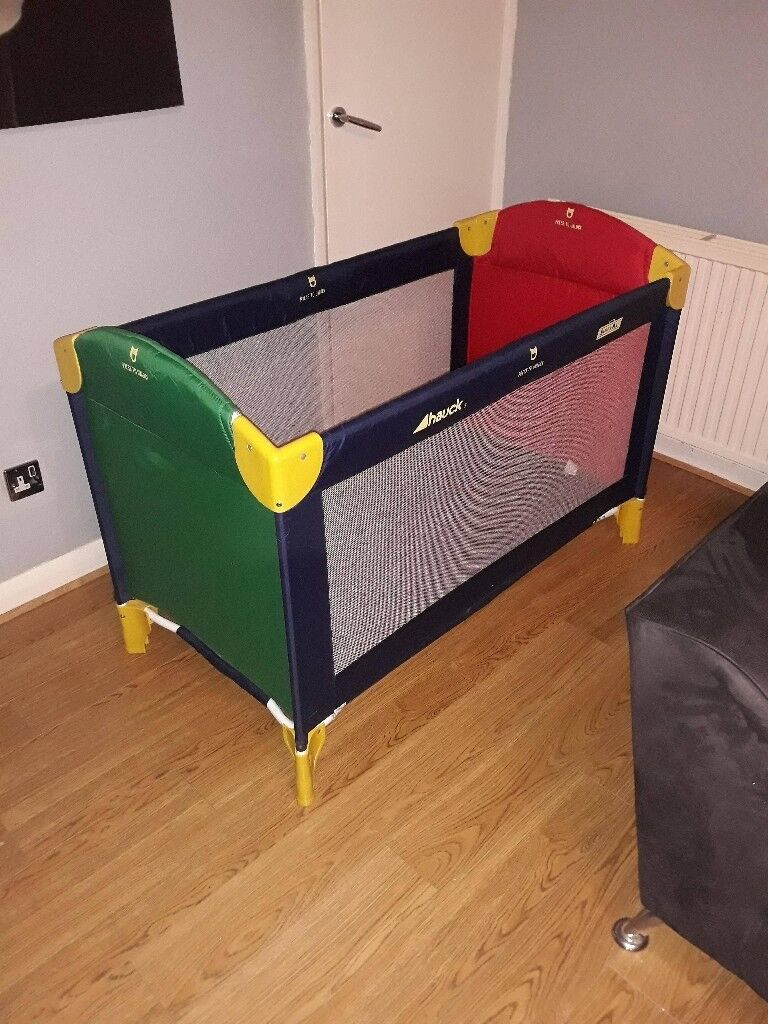 hauck multi coloured travel cot and playpen.