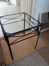 Black glass topped side table
