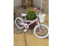 Very good quality girls bike, basket and helmet from Richards Bike Shop with stabilisers