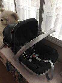 Emmaljunga car seat with hood