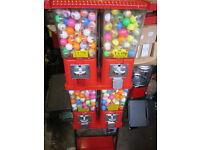 LARGE RED 4 IN ONE VENDING MACHINE FULL OF TOY CAPSULES .