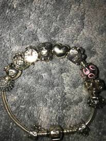 Pandora bracelet with 10 charms + saftey chain