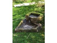 Two stone troughs (used as garden water feature)