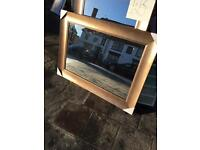 large wide wooden framed mirror with champagne finish