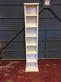 Tall white CD rack or storage shelving