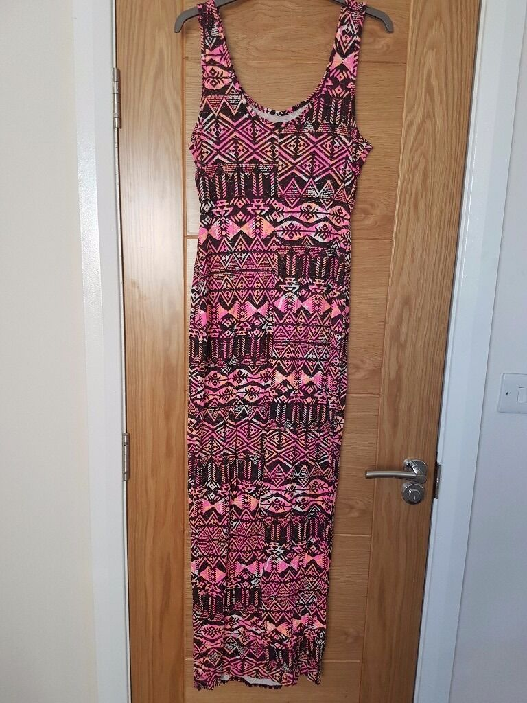 Summer dress with retro printin Redbridge, LondonGumtree - Summer dress with geometric print Size 14 Makes perfect for holiday and beach wear Interested? Then do not hesitate