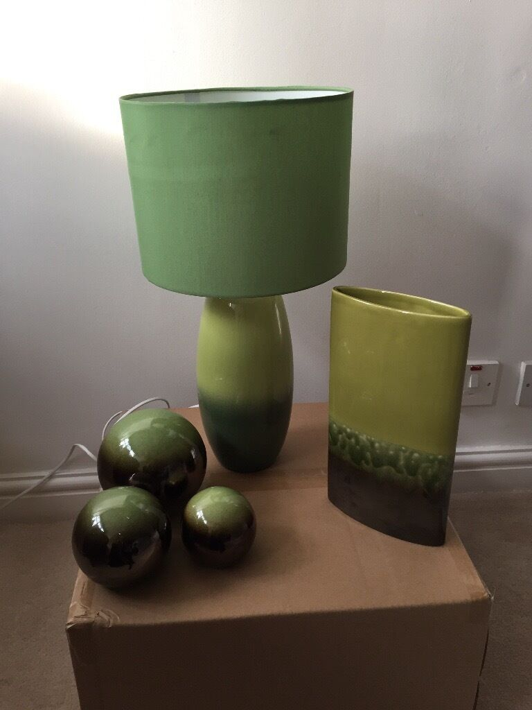 Green and brown lamp, vase and ornaments