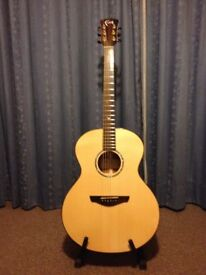 Faith Neptune Natural acoustic guitar with hard case. 18 months old in great condition.