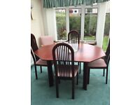 Dining table with four chairs plus a nest of coffee tables.
