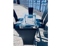 Glass and chrome table with 6 chairs