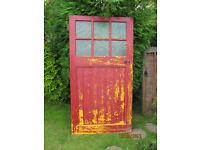 side hinged wood garage doors with glass top of each door