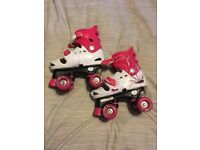 Osprey Quad skates - pink & white size 13-3 Extendable and not worn much.
