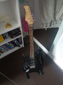 Electric Left-Handed Guitar + Stand