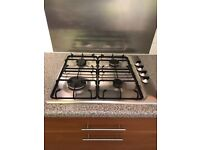 Gas hob and extractor hood