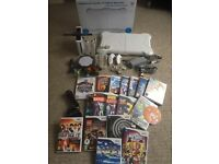 Wii Console + 2 Controllers + Fit Board + Skylanders + Mic + Loads of Games inc Sports Resort