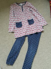 Red white and blue top with navy leggings